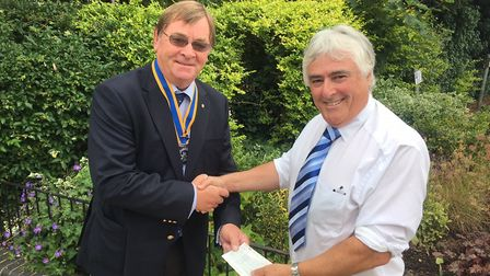 Malcolm Bugge, vice-president Great Yarmouth Haven Rotary Club, presents a donation to Richard Wrigh