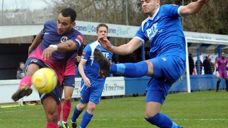 Bury Town's Connor Hall in action against Grays' Jordan Wilson during this afternoon's 2-0 home defe