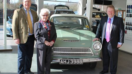 Pauline Turner with sons Ian and Glen at Hyundai Bury St Edmunds with a replica of the Ford Cortina