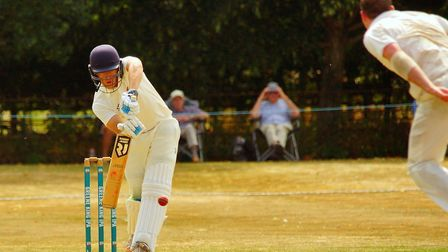 Old Buckenham youngster Matt Bint gets behind the ball during his Norfolk debut at Suffolk at Copdoc