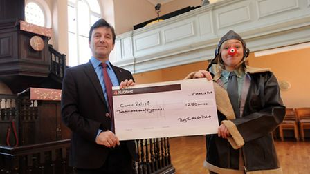 Tim Lodge and Katie Judge are pictured with a cheque raises by the Bury Theatre Workshop for Comic R