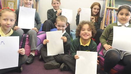 Pupils at Hillside Community Primary School work on their letters to their mothers.