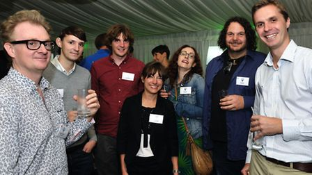 Matthew McGuchan, left, and Julien Mery, far right, with members of Visit Suffolk at a film conferen