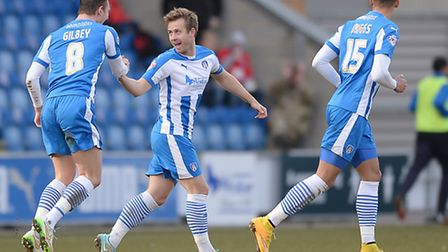 David Fox celebrates scoring Colchester United's second goal, from a free-kick, during Saturday's 3-