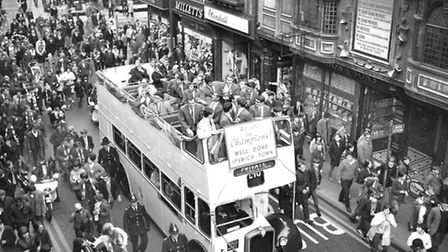 An open top bus ride through Ipswich for players and management after winning the Second Division Ch