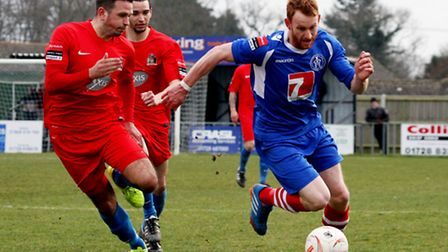 Leiston's Patrick Brothers attempts to get away from the challenge of Harrow's Josh Webb