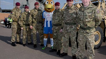 Image of Colchester FC mascot Eddie the Eagle with soldiers from 16 Air Assault Brigade.