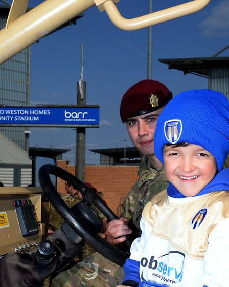 Image of Oliver Charles Vine, seven, from Clacton with a soldier from 16 Air Assault Brigade