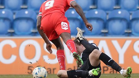 Crawley striker Izale McLeod is adjudged to have been fouled by U's keeper Sam Walker, which resulte