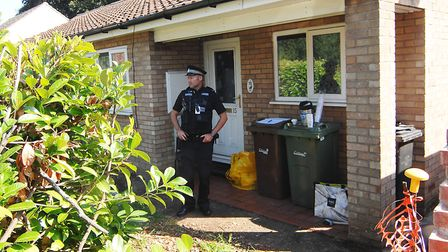 A police officer at the house in Whytehead Gardens, Diss, where a woman's body was found Picture: C