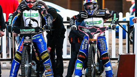 Ready for the off: Danny King (left) and Ritchie Hawkins about to be pushed off for the opening heat