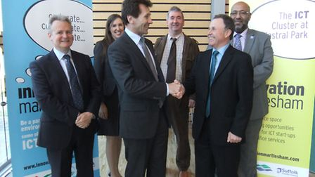 Jeremy Goulding, front, left, chief executive of Wheatley, is congratulated by Innovatioin Martlesha