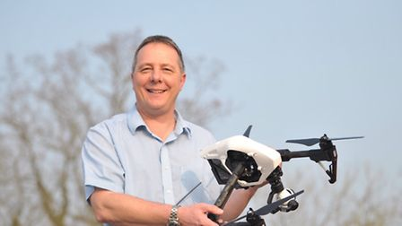 Fram Farmers conference about Drones. Ian Caley with one of the drones.