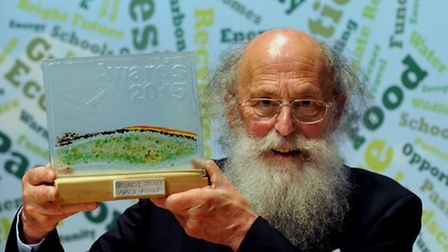 Suffolks Green Hero 2015 Leonard Woolf proudly holds aloft his trophy at the environmental awards c