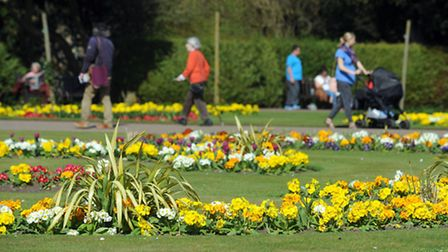 People enjoying the warm weather in the Abbey Gardens in Bury