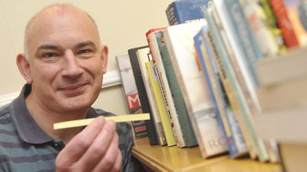 Steve Blake, founder of The Puzzle Room, sets up a library at the Kesgrave Community Centre as a lib