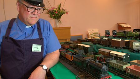 The Revd Martin Dawes with his model train lay out at Woodbridge Methodist Church during the Toy and