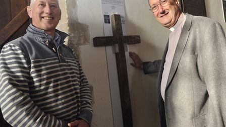 Guy Marshall found a wooden cross in St Bartholomew's Church shed in Orford last year. With Rev Davi