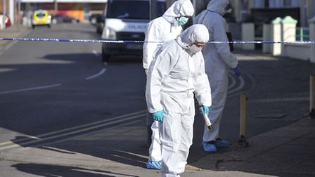 Essex Police forensics examine an area in Clacton town centre after a man was murdered Monday night.