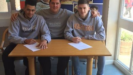 Luke Mascall-Wright, left, Ipswich head coach Nick Drane and Sam Newman, right, sign for US colleges