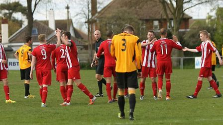 Felixstowe's Duane Wright (11) receives congratulations from team-mates