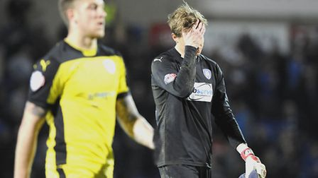 Chris Lewington holds his head at the end of his Colchester United league debut at Chesterfield