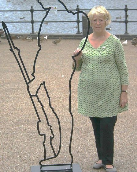 Pat Mordey of Rotary Club of Diss Waveney with the Tommy silhouette that will be part of events in D
