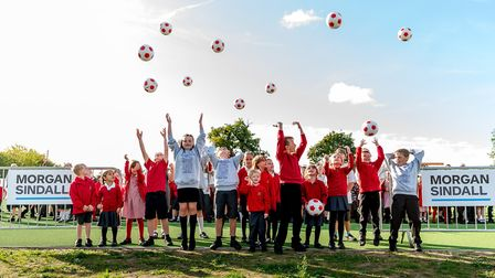 Roydon Primary School pupils take part in a special celebration to open the new sports pitch part of