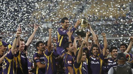 Players and support staff of Kolkata Knight Riders celebrate with the trophy after their win against