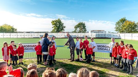 Headteacher Sarah Bradford oversees the cutting of the ribbon to open Roydon Primary School's new sp