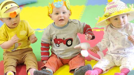 Mums and their children don Easter bonnets at the Daisy Foundations Wrigglers class in Kesgrave.