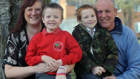 Joshua Brooks (5)(wearing red jumper) suffered a brain injury after getting chicken pox encephalitis