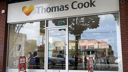 Thomas Cook has reported improved bookings in the UK but with prices remaining under pressure.