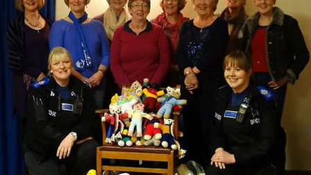 Police Community Support Officers (PCSOs) Gemma Cheek and Terrie Johnson with members of the WI grou