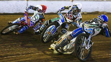 Rohan Tungate slides off on the outside in heat four, with Stefan Nieslen (blue) and Richie Worrall