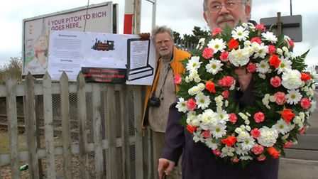 Harry Dangerfield (right) and Mike Ninnmey lay a wreath on the site of the former Beach Station in F