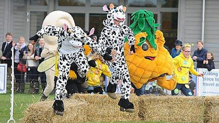 Suffolk Young Farmers mascot, Supermoo (centre) triumphed at the inaugural mascot race last year