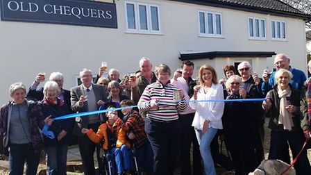 Villagers and guests celebrate the reopening of the Old Chequers Inn in Friston