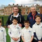 Graham Gooch and Essex CCC academy director John Childs with students