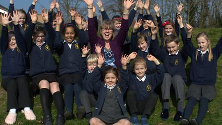 Kelsale CEVC Primary School pupils and headteacher, Carolyn Taylor, celebrate receiving an 'outstand