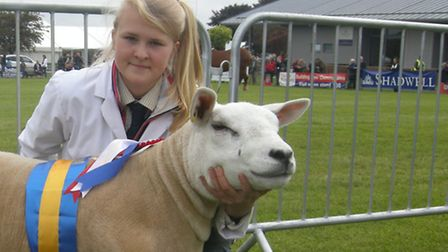 Charlotte Cobbald with her champion Texel shearling ewe at the Suffolk Show