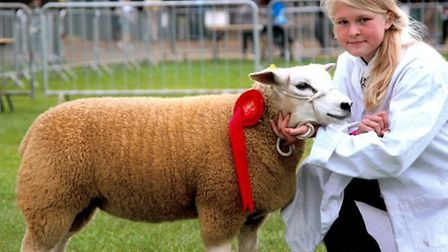 Charlotte Cobbald at the Suffolk Show with one of her winning Texel sheep. Picture by Anthony Mosley