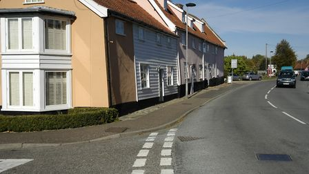Traditional white and pink coloured properties in Fair Green, part of the Diss Conservation Area. Pi