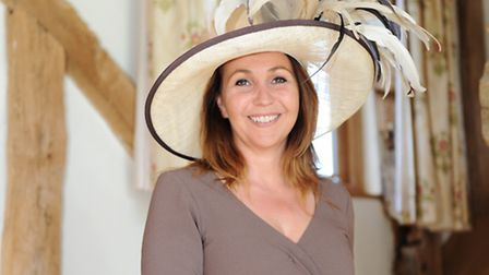 Kate Baker, wife of show director Bill Baker, wears a light coffee dress from a Brighton boutique an