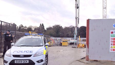 Essex Police cordon off the entrance to the construction site at King Edward Quay in Hythe after Dav