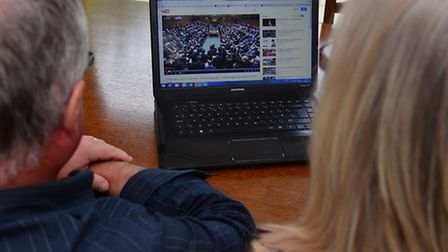 Alan and Denise Burgess look at a video on the computer regarding the blood contamination scandal of