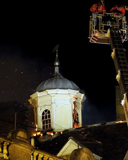 Firefighters battle to tackle the major fire in the historic Cupola House in the Traverse, Bury St E