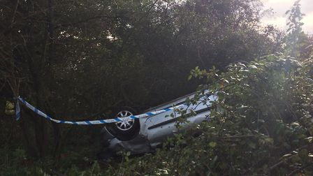 A car rolled over after hitting a post outside Diss Golf Club. PHOTO; Sophie Smith