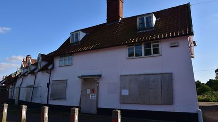 The boarded up former Kings Head Inn stands at the centre of Pulham St Mary. Picture: Sonya Duncan