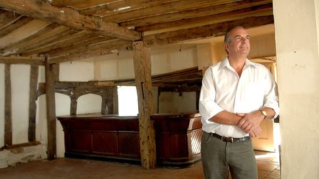 Owner Graham Scott pictured in 2009 inside the old King's Head Inn in Pulham St Mary. Picture: Denis